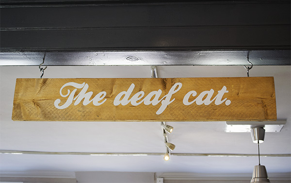 The Deaf Cat Coffee sign in Rochester