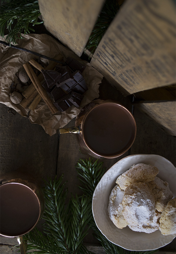 copper mugs from Mia Fleur, filled with my spiced hot chocolate recipe and accompanied by Italian ricciarelli biscuits