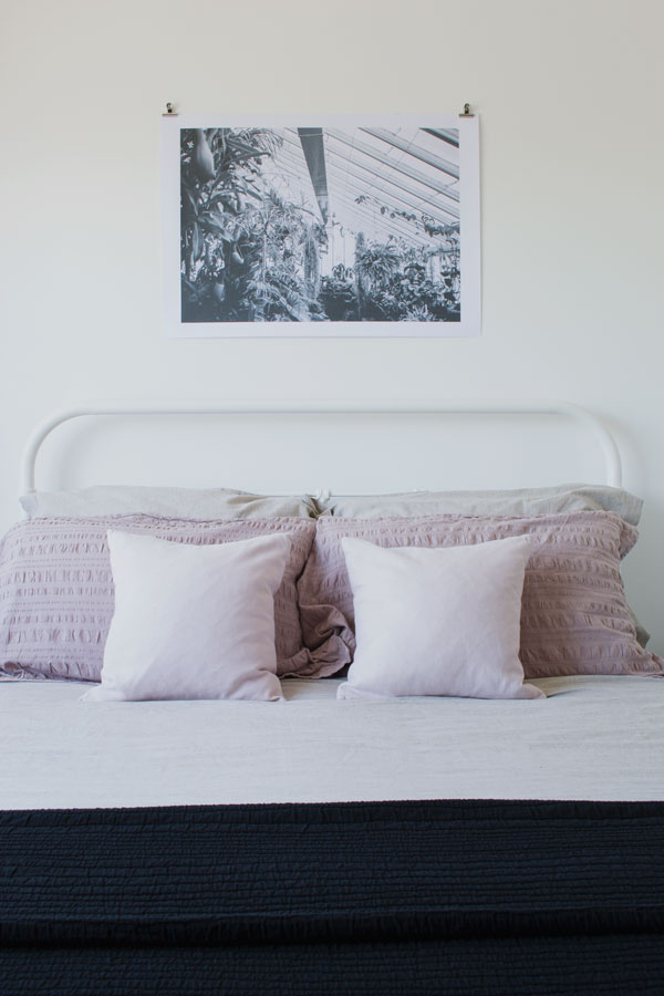 Adding art is one of my 6 styling tips for a minimal bedroom