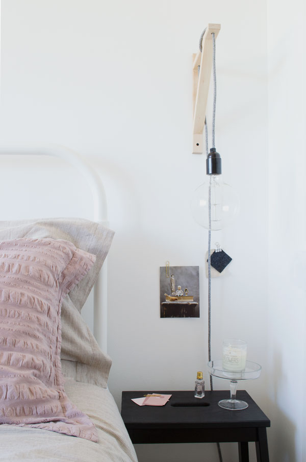 bedside lamps created with vintage style Edison bulbs, fabric cable mounted with IKEA brackets is one of my styling tips for a minimal bedroom