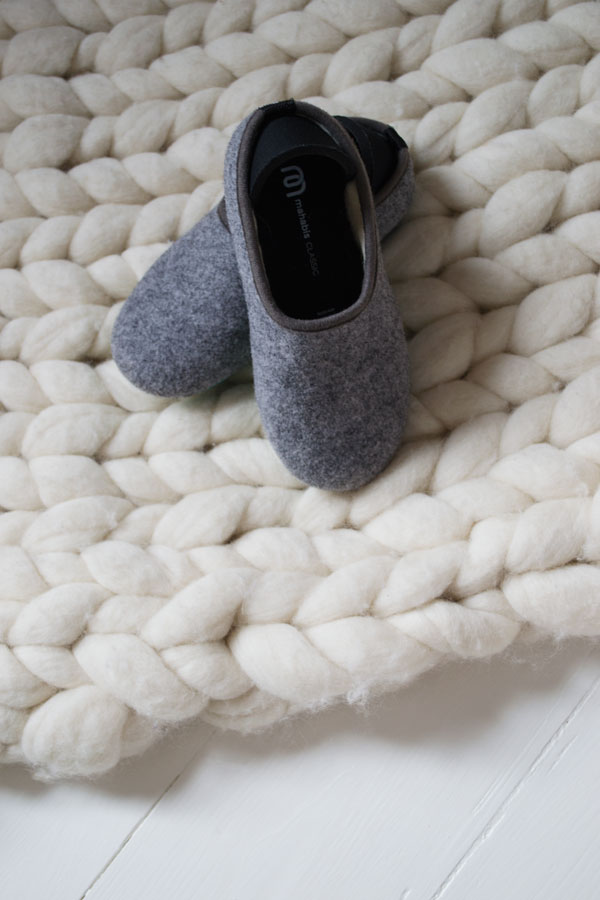 mahabis kids slippers with an outdoor indoor sole and sheep wool inside.