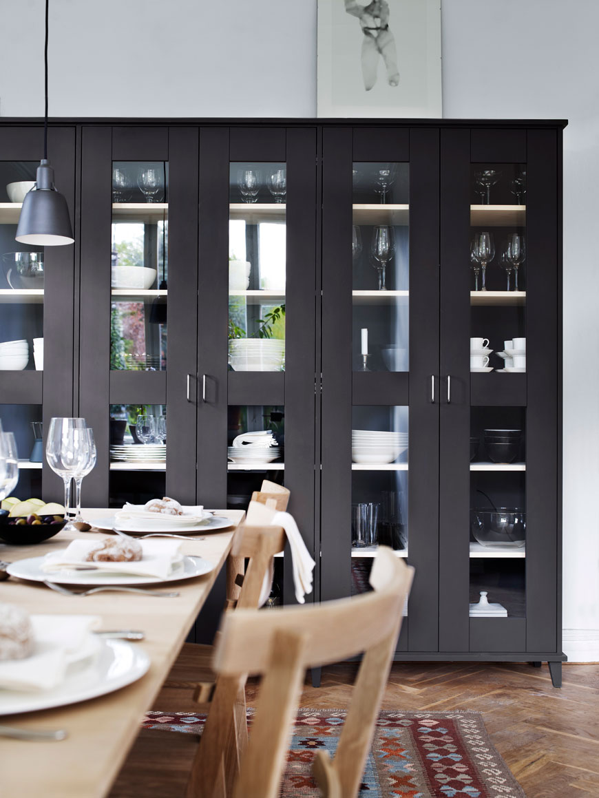 A wall of charcoal grey glass fronted storage cabinets designed by Norrgavel, sustainable Swedish furniture designers.