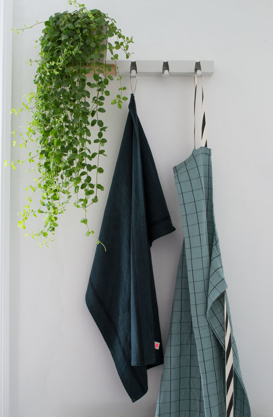 Metal hanging rail kitchen, hanging plants in the kitchen, blue kitchen linens, Dutch design, white kitchen