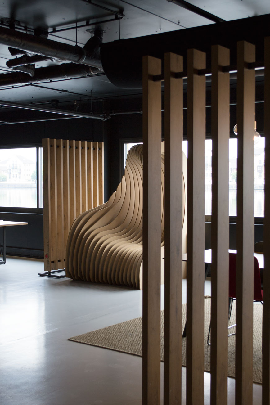 Sleek and industrial wood screening zones in the social spaces at Good Hotel London