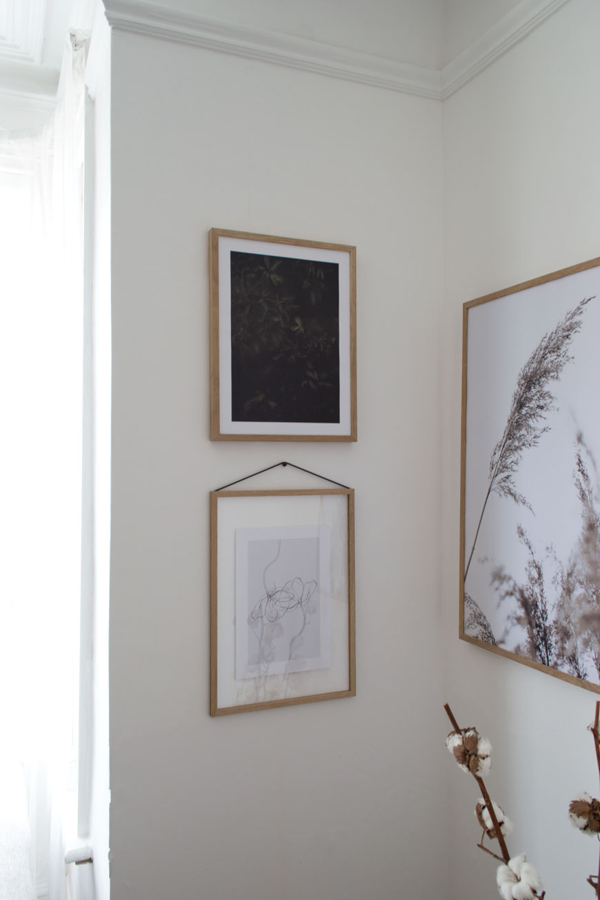 Living room gallery wall consisting of minimal art prints from Scandinavian art company, Desenio.