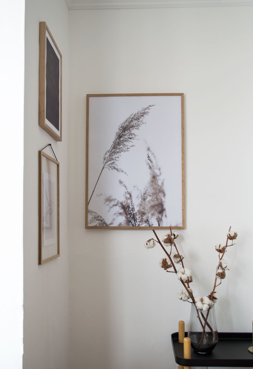 minimalist art prints, gallery wall, Scandinavian art, white interiors, white living room with Edwardian coving, cotton flowers in a clear vases on Normann Copenhagen trolley.