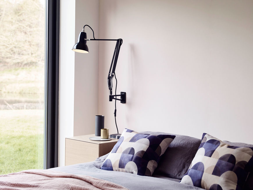 black wall lights, black wall lamps, Anglepoise Original 1227 wall light, industrial wall lighting, Imogen Heath Viaduct cushions in blue, pink bedroom walls