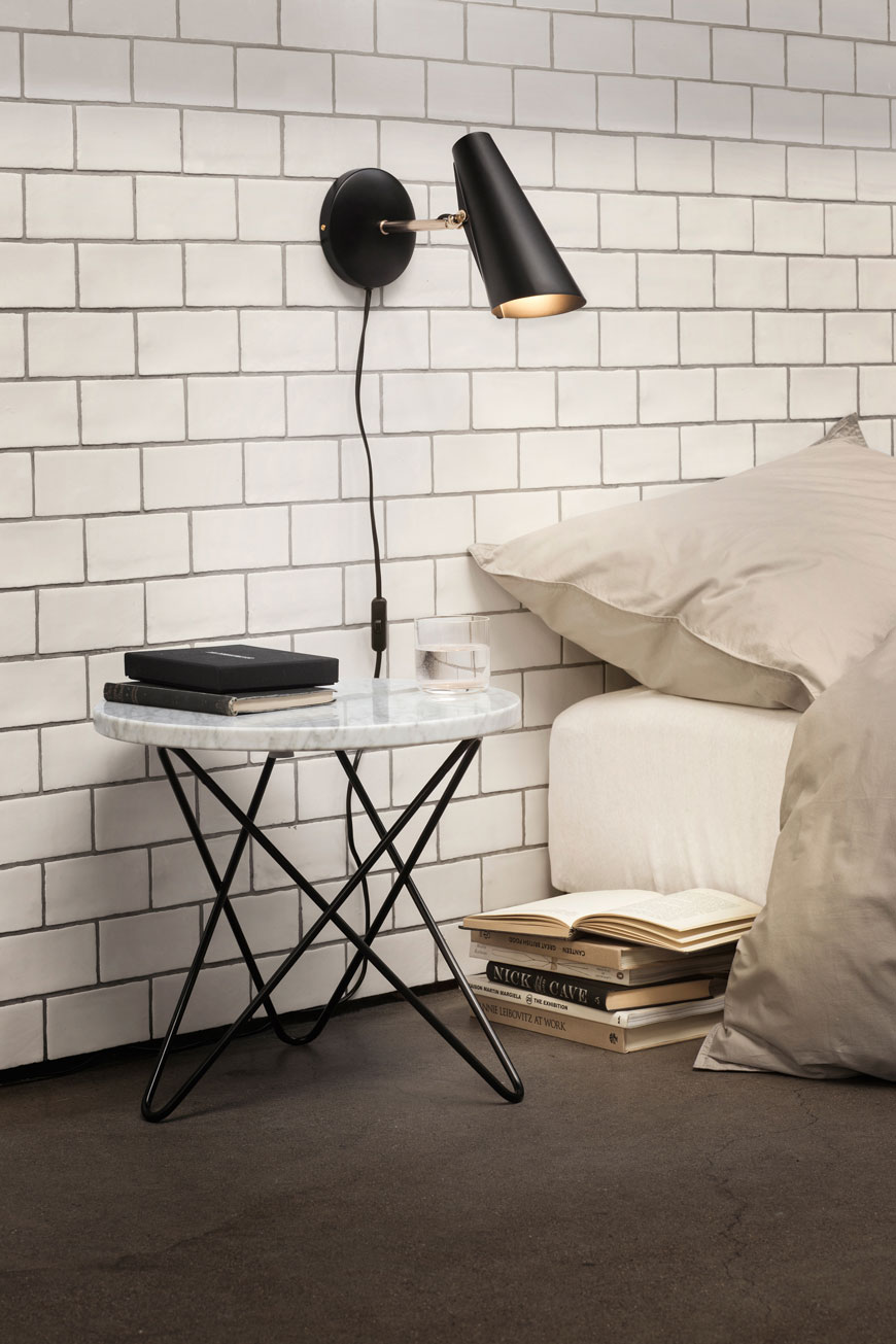 black wall lights, black wall lamps, black wall light on white tiled wall, marble bedside table, modernist lighting, Birger Dahl Birdy light, Northern