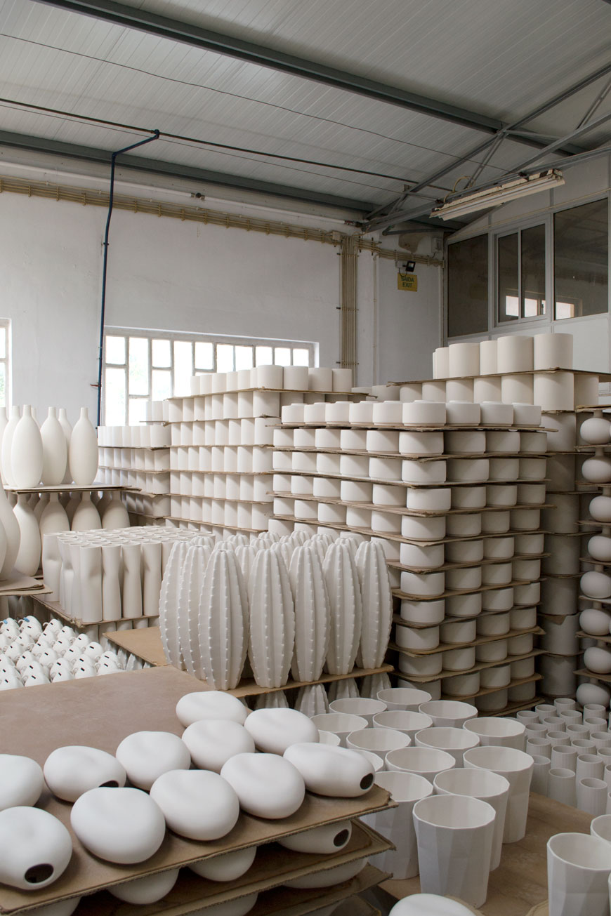 Stacks of white bisque ceramics waiting for glazing in the ceramics factory in Portugal.