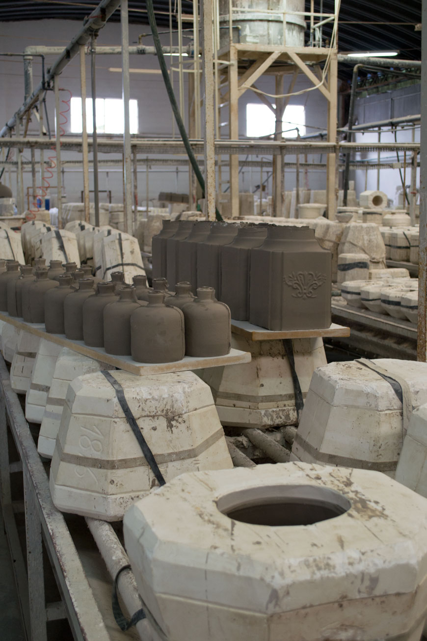 Clay vases fresh out the mould sit air drying in a ceramics factory in Portugal