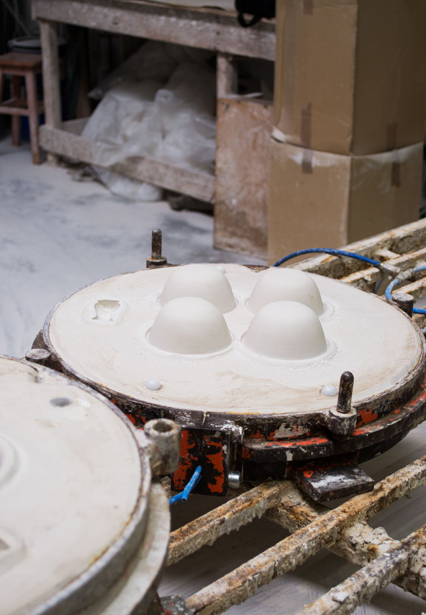 A plaster mould for a set of bowls sits in the workshop at a ceramics factory in Portugal