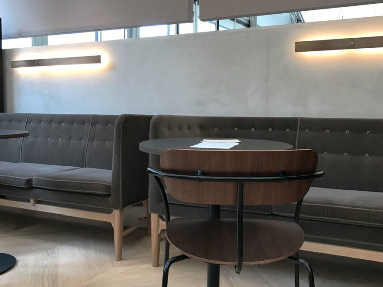 Dark grey velvet &Tradition Mayor sofas sit against a grey plaster wall in the STILL pop-up restaurant.