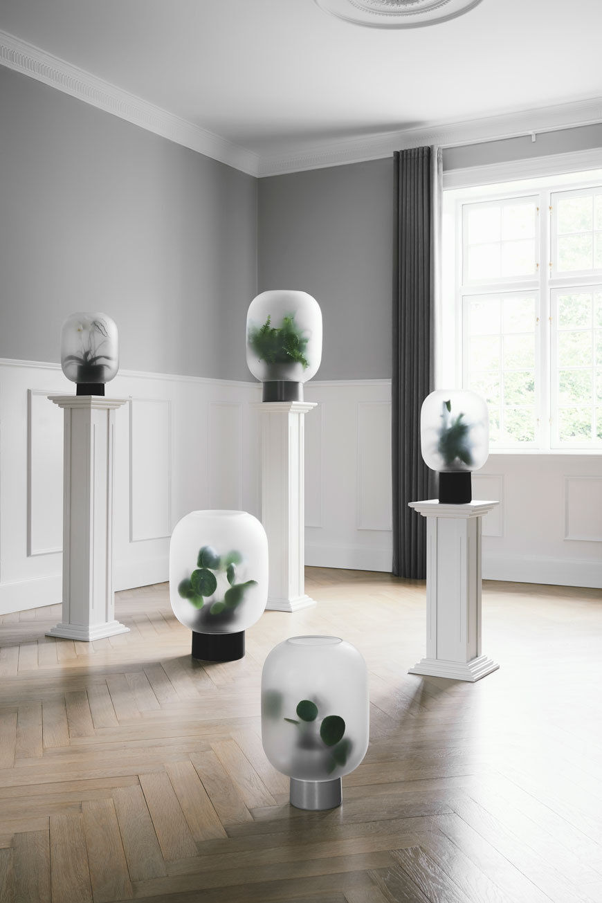 Frosted glass Nebl planters on pedestals designed by Nordic design brand Gejst.