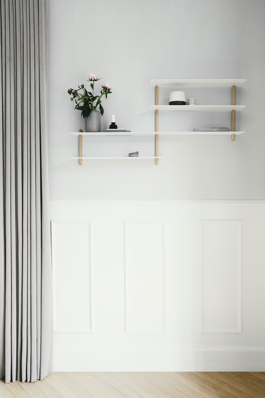 Minimalist white and oak shelves in a grey living room by Nordic design brand Gejst
