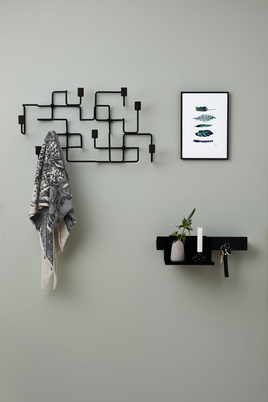 London underground inspired coat rack in the hallway, by Nordic design brand Gejst