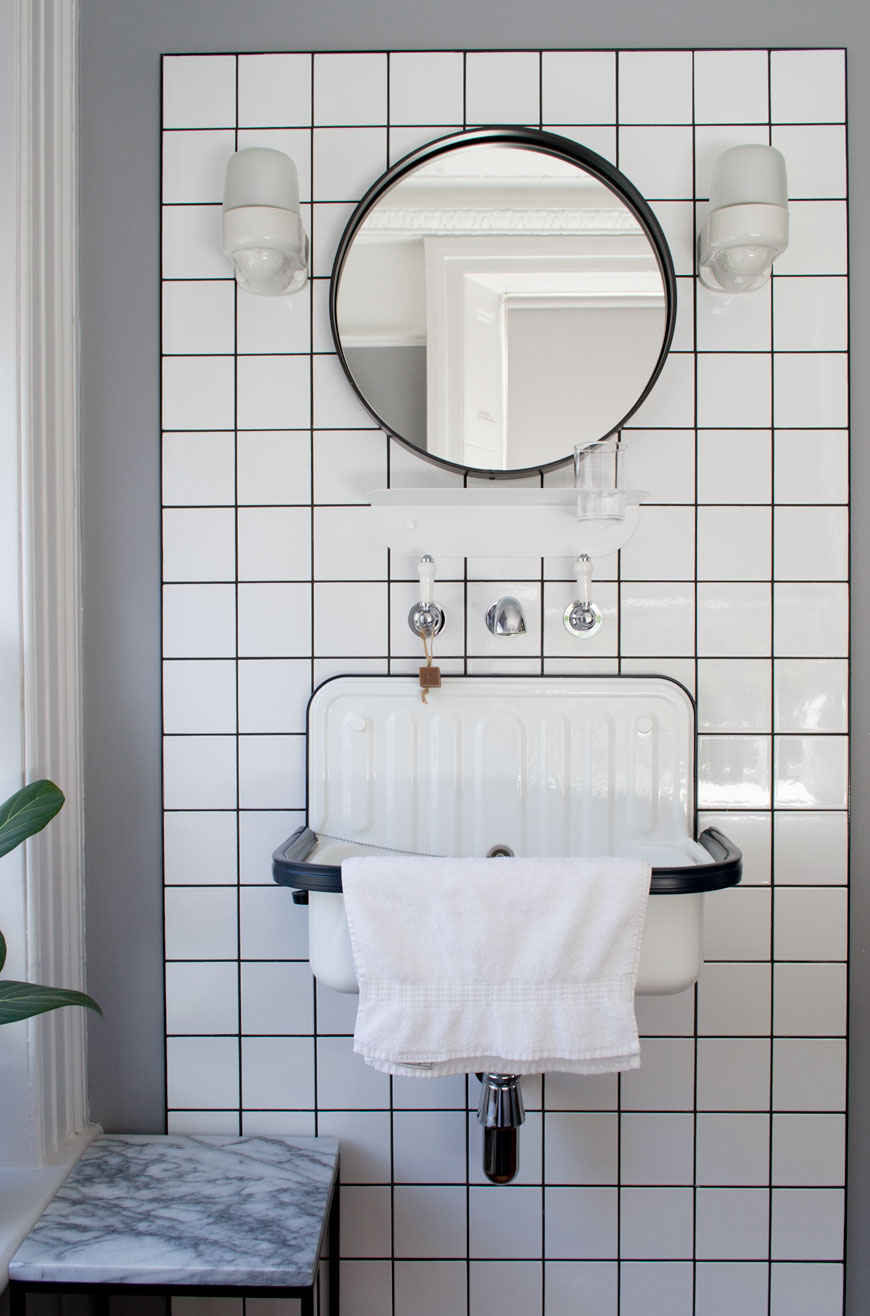 wall mounted vintage enamel sink and black and white tiling at The Pilgrm Hotel.