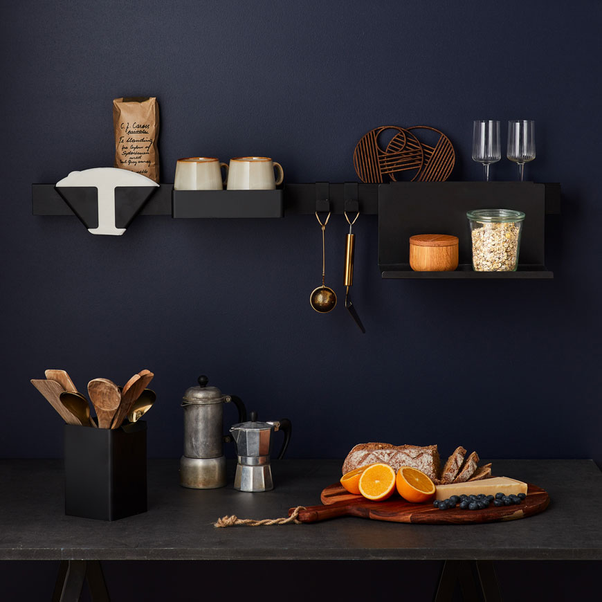 Black Flex rail wall mounted in a blue kitchen with coffee making utensils, designed by Nordic design brand Gejst.