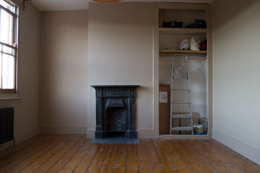 Our half decorated beige bedroom waiting for the engineered oak floor to arrive.