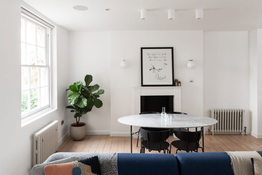 A grey marble table sits inside the living room of this Georgian Hackney home