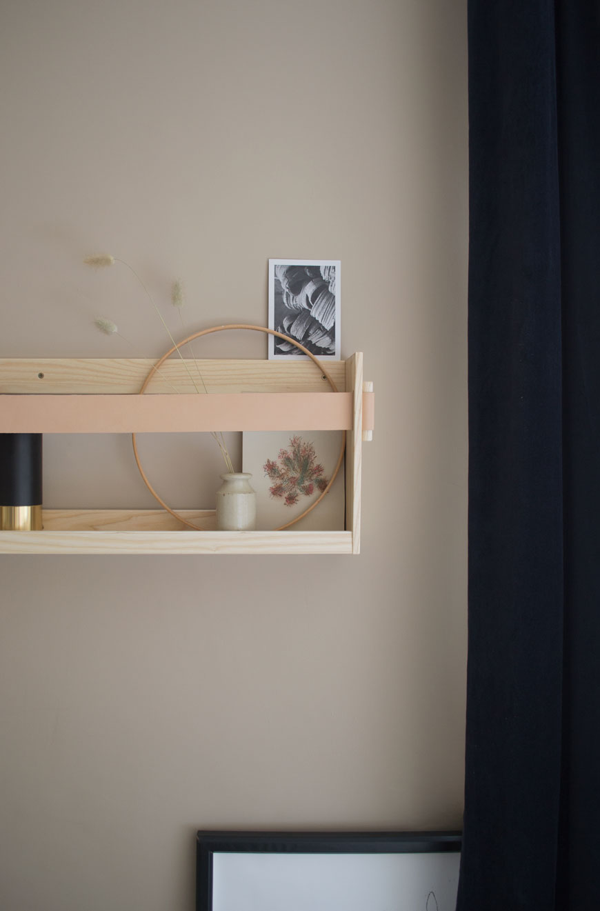 A Scandi inspired Nordic luxe bedroom with a wood and leather shelf by SSM.