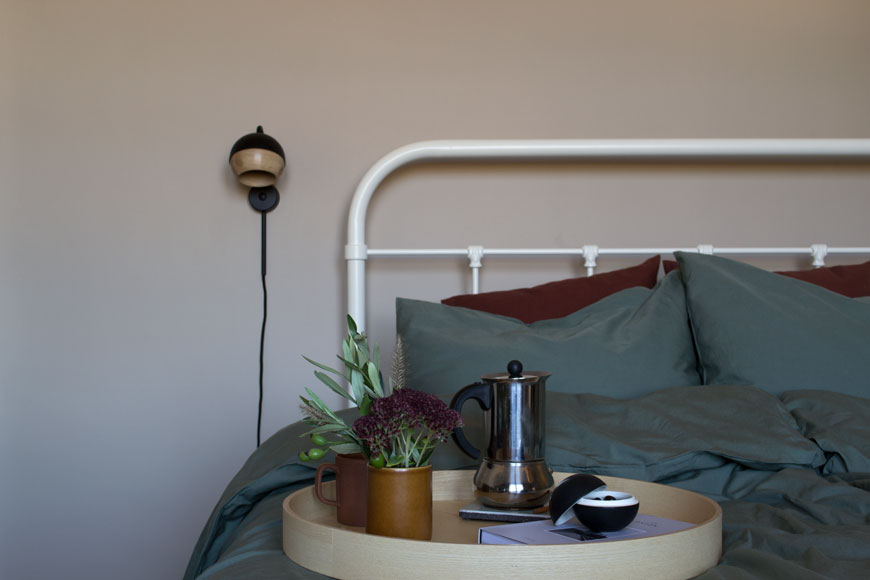 How to style your home for winter with breakfast in bed with dark green cotton bedding and a tray with coffee, from NABO shop