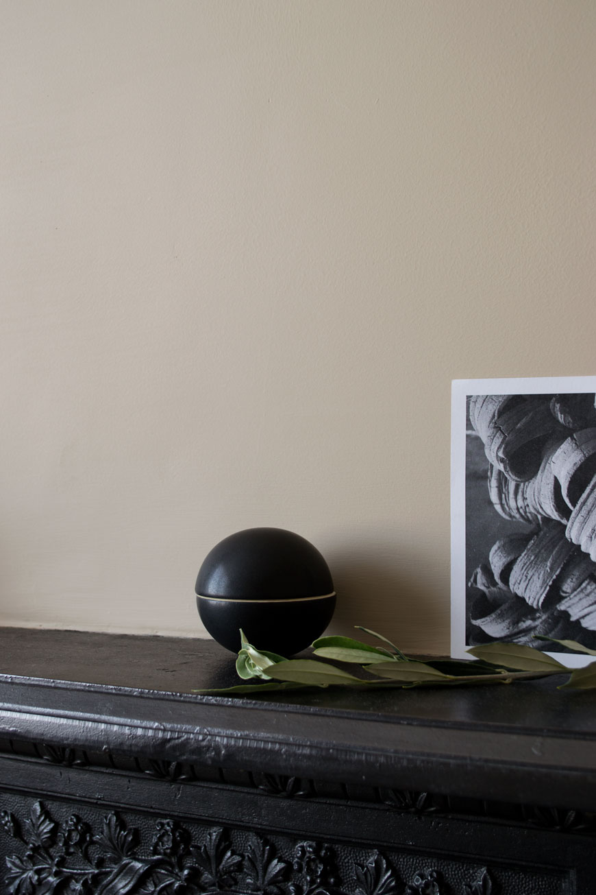 how to style your home for winter with a black round ceramic bonbon pot from NABO shop which sits on a Victorian mantlepiece.