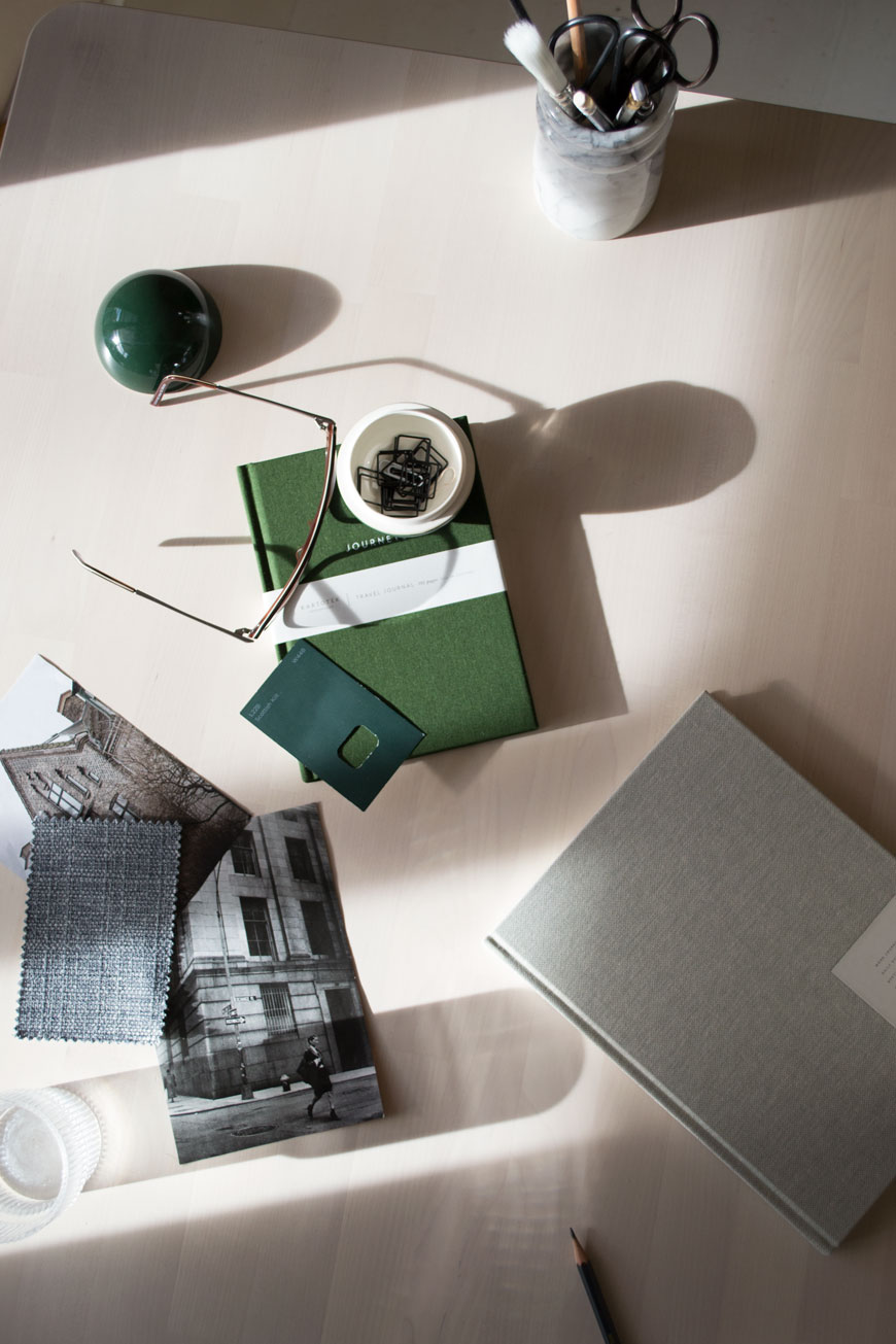Stark shadows across a desk with green and grey Danish stationery from NABO