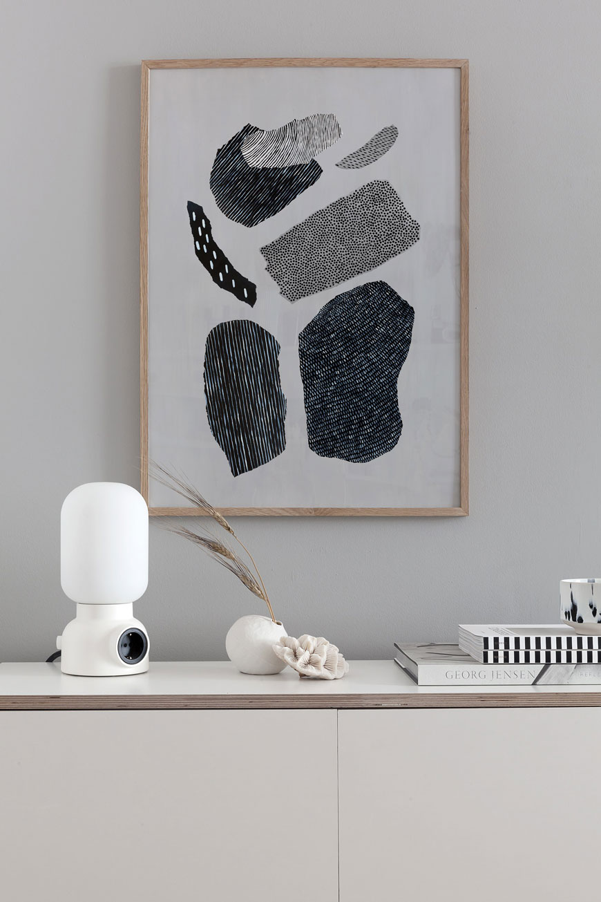 Abstract wall art styled above a plywood sideboard, designed by Coco Lapine Design.