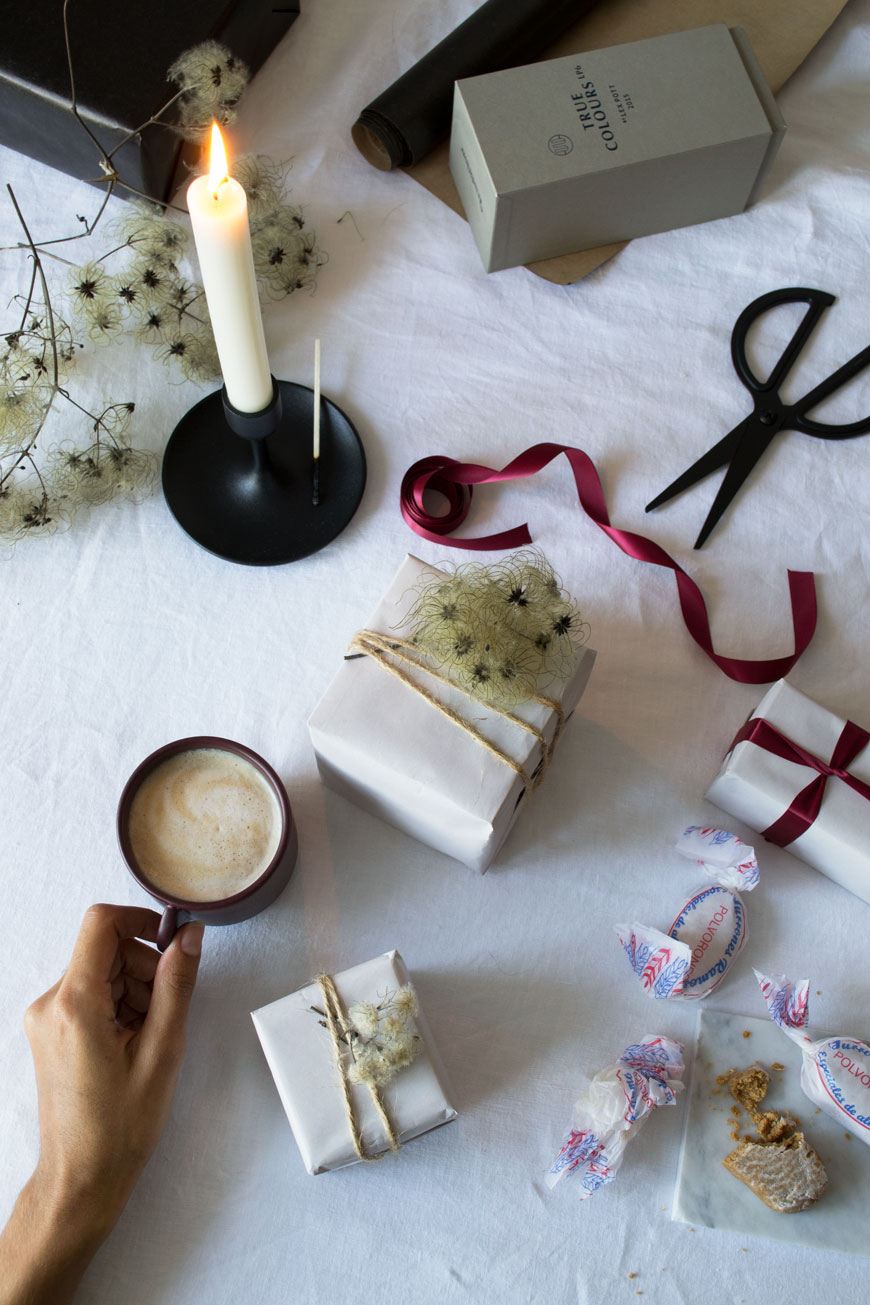 A present wrapping flatlay on my dining table, sharing tips for natural, Nordic Christmas decorations