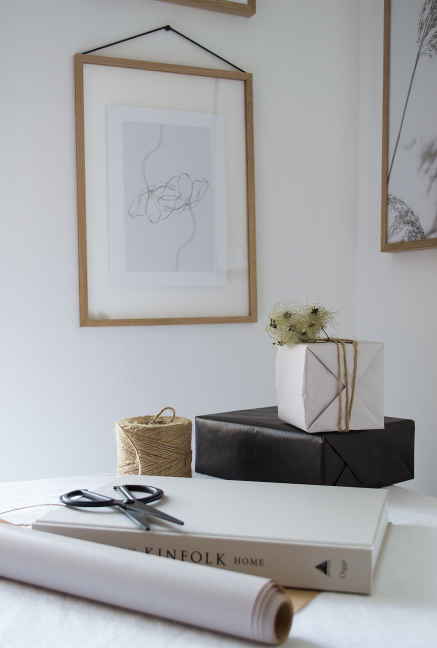 Wrapping gifts on the table with black and white gift wrap, sharing my tips for Nordic Christmas style.
