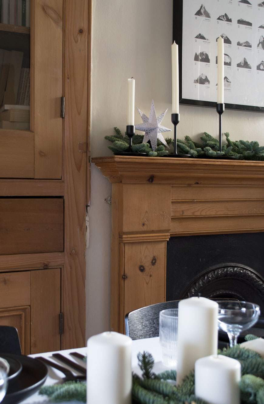Festive dressed Edwardian mantlepiece sharing styling tips for Nordic Christmas decorations.