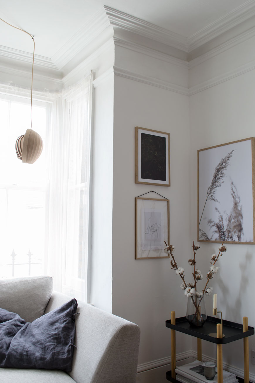 White and grey Scandinavian living room with botanical art and the 6 things I've learnt about slow decorating