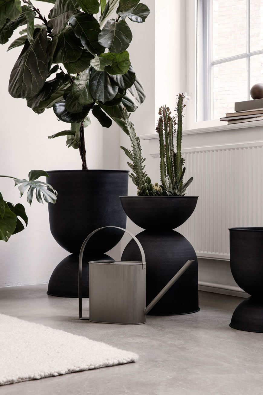 Giant black metal hourglass vases make a statement in the SS19 Ferm Living catalogue.