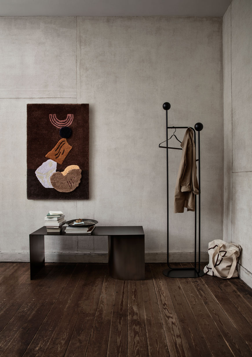 A minimalist hallway with tufted wall hanger from the Ferm Living SS 2019 catalogue.