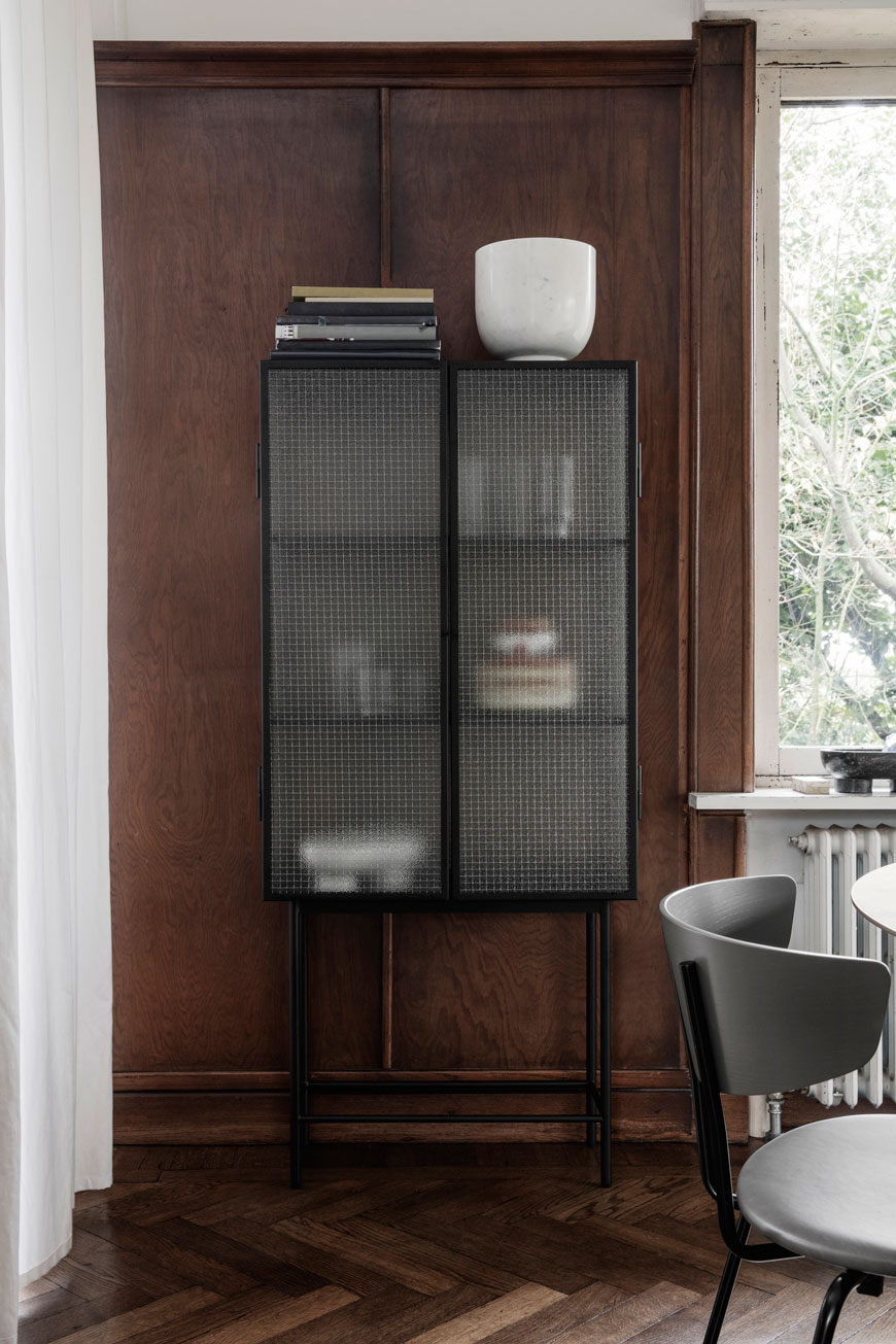 Haze Vitrine with a slim black metal frame and diffused glass front, designed by Ferm Living.