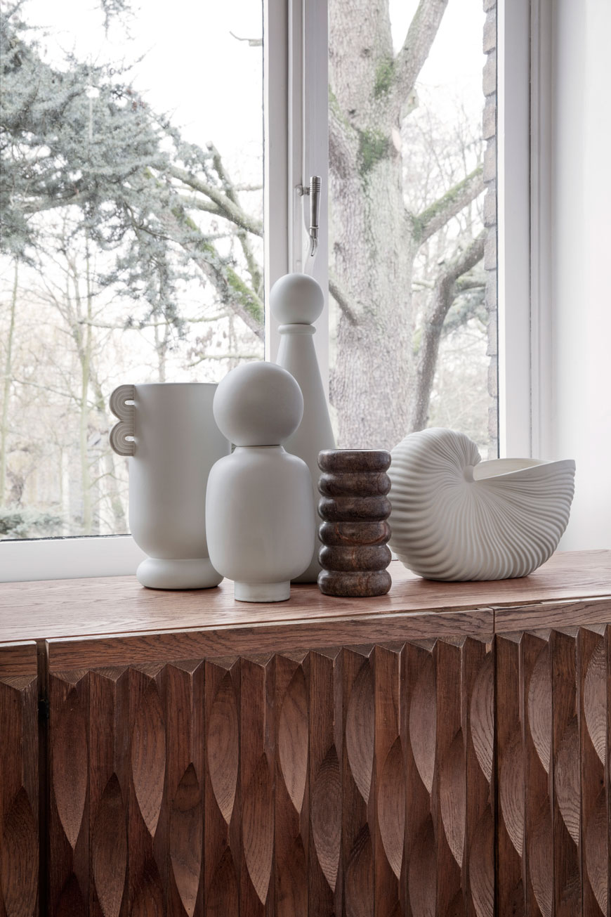A collection of white and brown marble vases and pots in the Ferm Living SS 2019 catalogue.