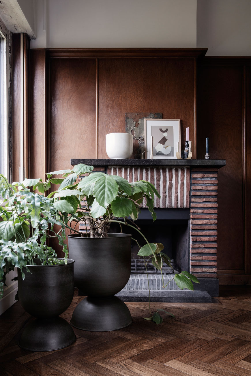 Giant black metal planters feature in the Ferm Living 2019 catalogue.