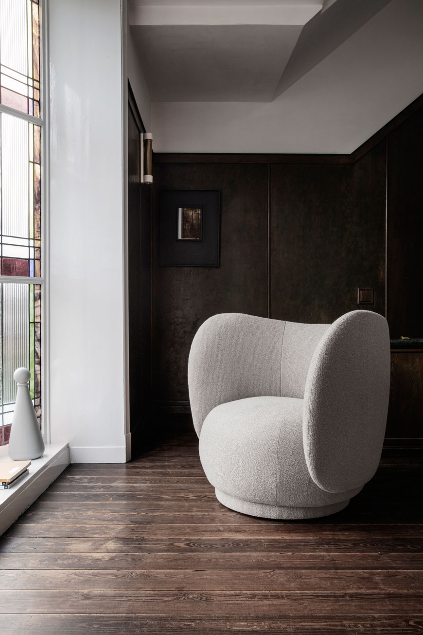A dark and moody interior sets of the pale and interesting Rico lounge chair, designed by Ferm Living.