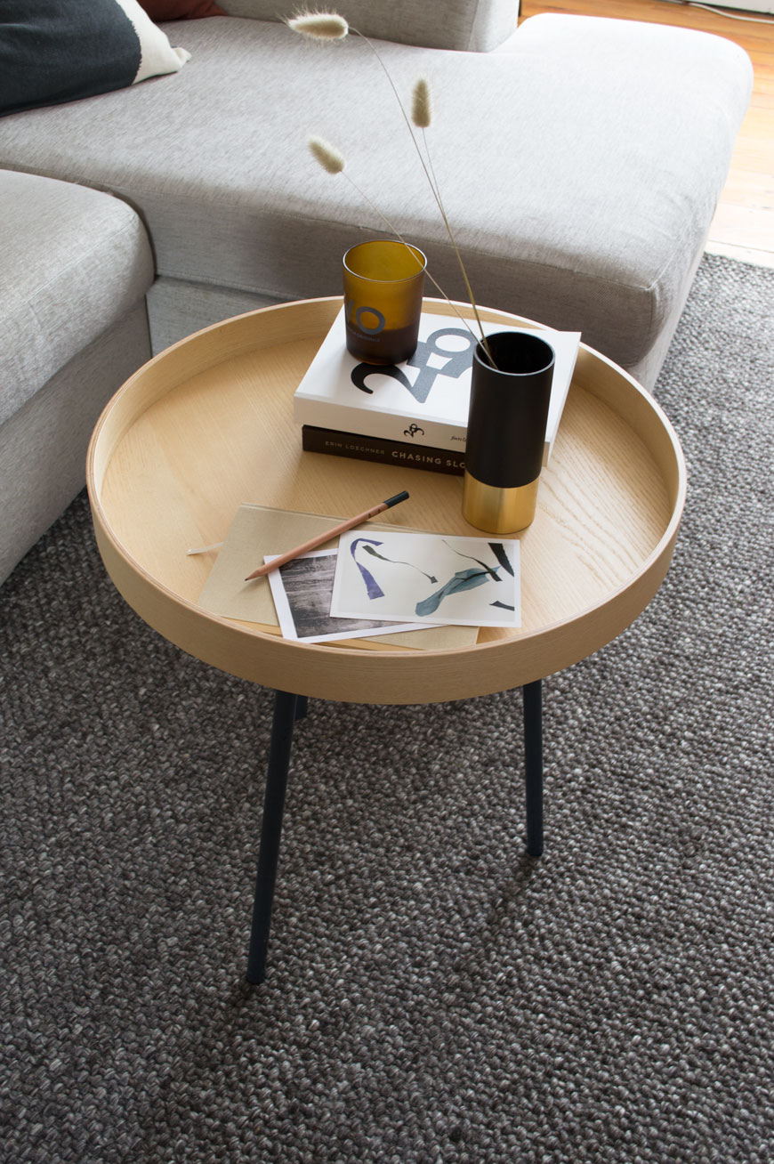 A small tray acts as a coffee table on top of a timeless grey rug from Habitat.