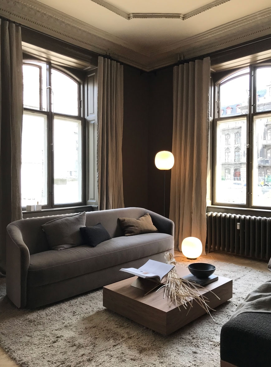 A dark and moody living room with period features inside the New Works showroom in Copenhagen.