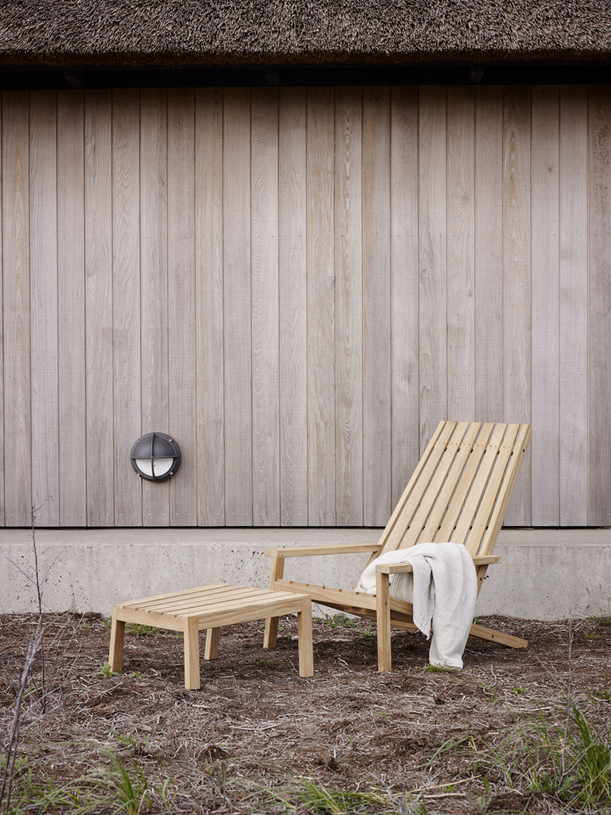 A slatted deck chair illustrates Modern Scandi outdoor furniture style.