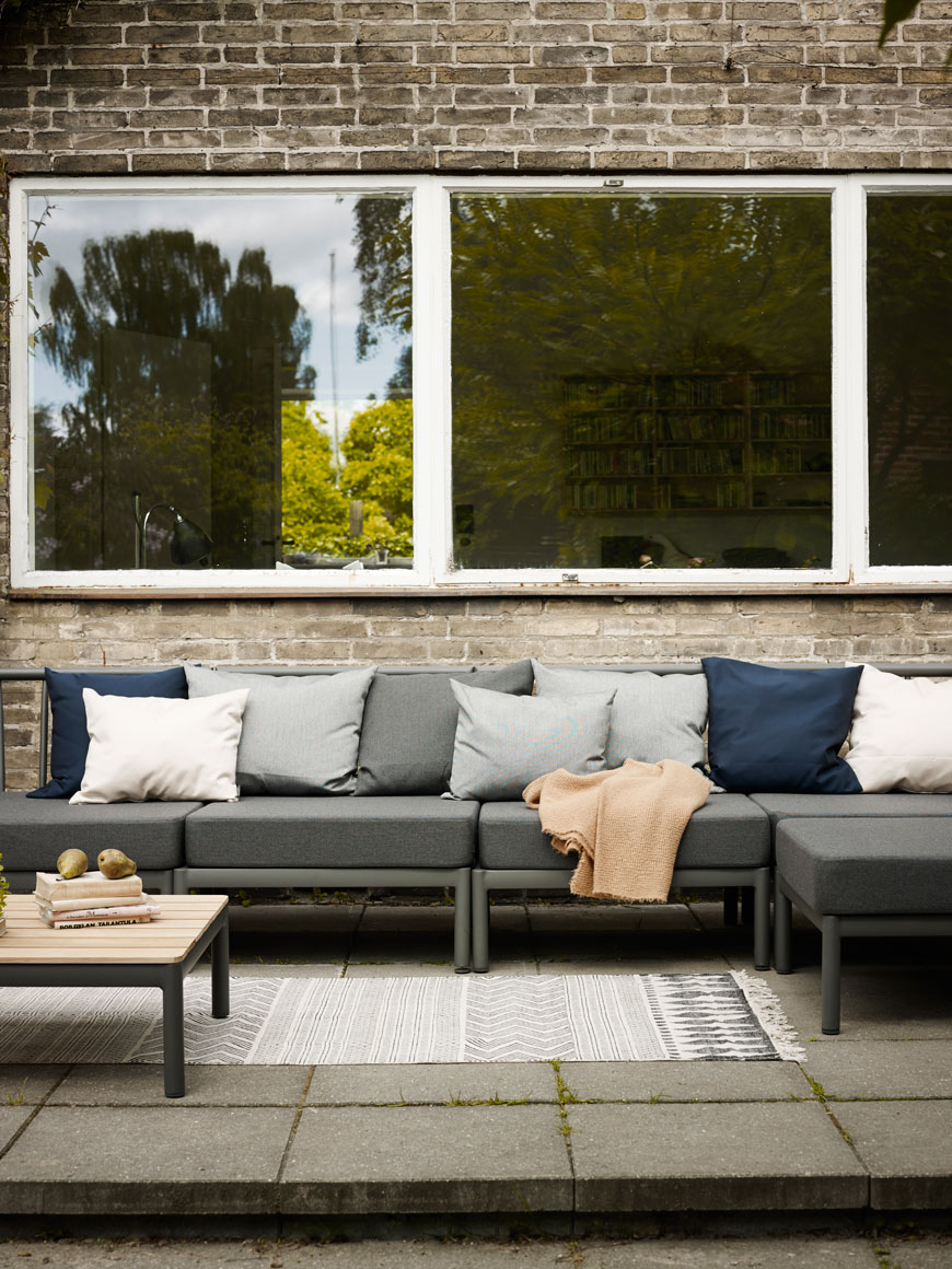 A grey modular sofa is a great option for outdoor furniture if you're having large gatherings.