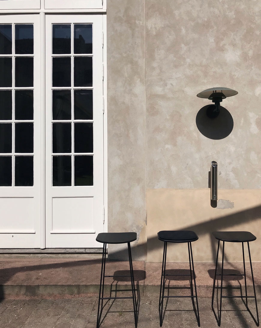 Three black stools line up outside the odd fellows mansion in Copenhagen at 3daysofdesign