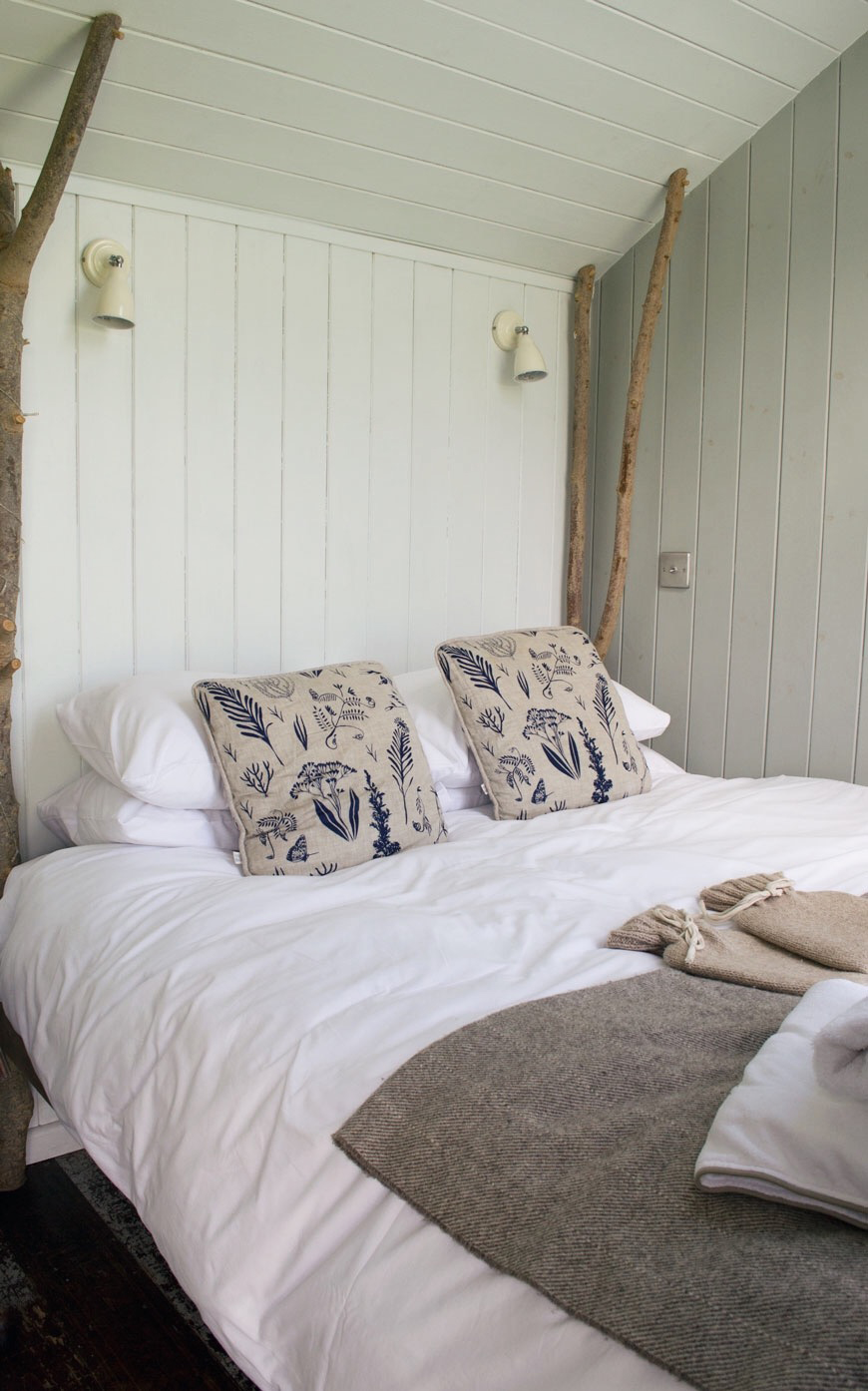 A plump and cozy kingsize ash four poster bed inside Vanellus at Elmley Nature Reserve.