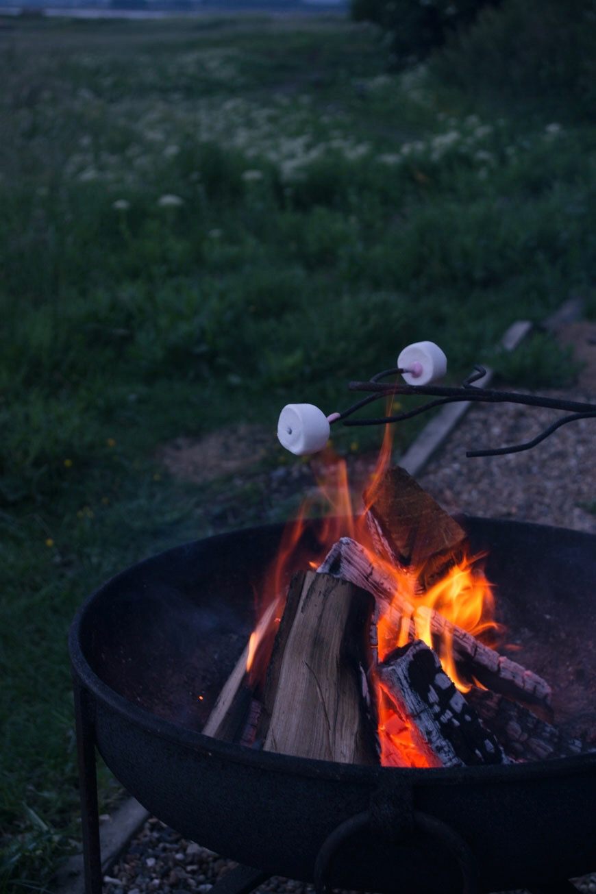 Toasting pink marshmallows over the iron firepit at sunset on Elmley Nature Reserve.