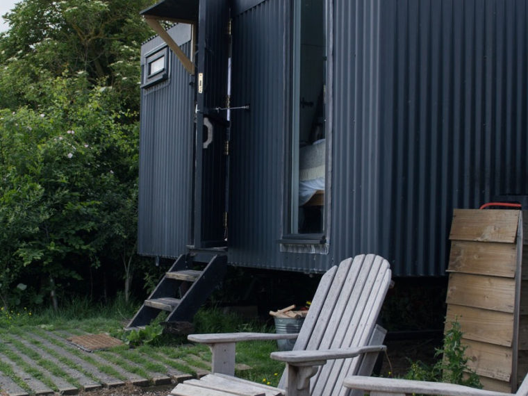 Outside Vanellus Shepherd's Hut by the firepit at Elmley Nature Reserve in Kent.