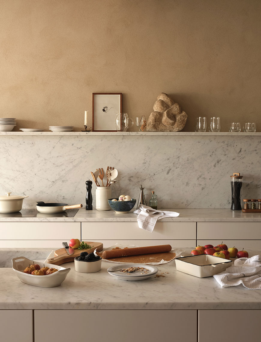 Warm honey spice lime painted walls and marble countertops create a lived-in look for the Zara Home Autumn-Winter collection.