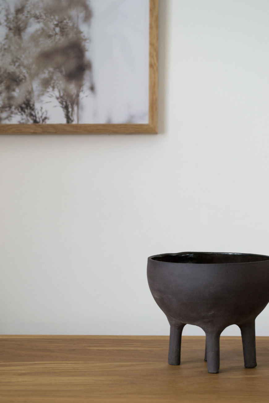 A sweet little handmade black stoneware pot, created by Massa Design Studio in Israel.