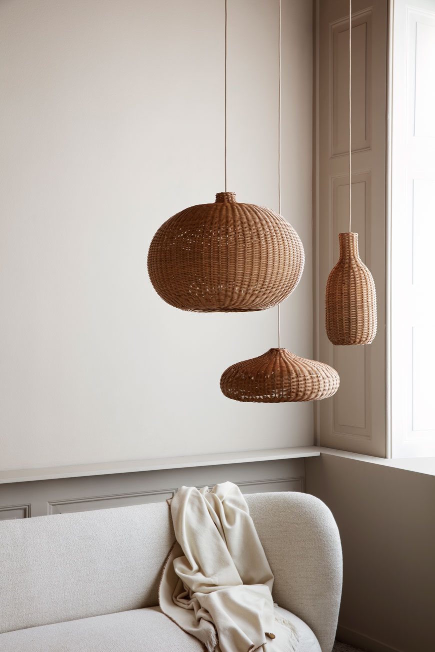 Ferm Living Braided Belly light shades hang in a neutral and minimal living space.