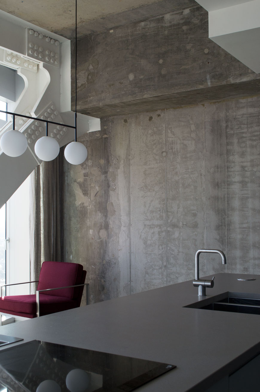 A raw, industrial loft apartment with exposed concrete walls at The Stratford hotel, London.